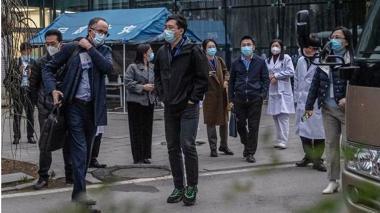 OMS visita mercado donde se dieron los primeros contagios en Wuhan