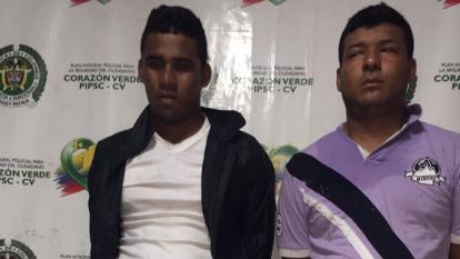 Eiver Charris Gutiérrez y Fabio Meneses Beleño, capturados, en la URI de la Fiscalía.