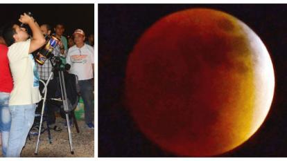 Con binoculares y telescopios los asistentes al malecón de Puerto Colombia pudieron contemplar la luna roja.