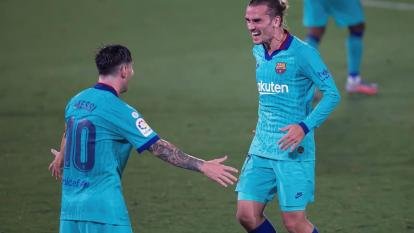 Antoine Griezmann celebrando su golazo con Lionel Messi.