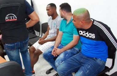 Tres de los capturados, en audiencia de imputación de cargos.