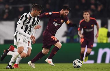 Acción durante el encuentro entre Juventus y Barcelona.