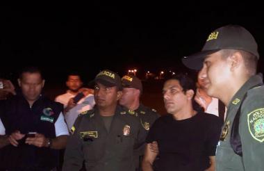 Assi Mosh cuando era conducido por la Policía Nacional.