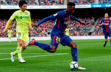 El defensa central colombiano Yerry Mina actuando con el Barcelona FC.