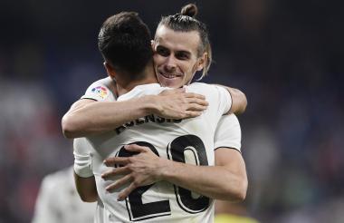 Bale celebra con Asensio.