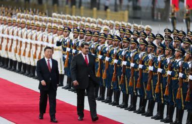 Los presidentes Xi Jinping (izq), y Maduro, en Beijing.