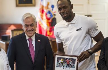 Sebastián Piñera junto a Usain Bolt