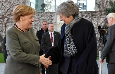 Angela Merkel y Theresa May.