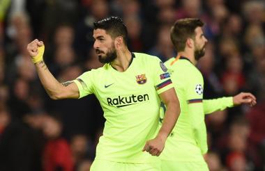 Suárez celebra el tanto frente al Manchester United.