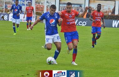 John Duque, de Millonarios, y Daniel Giraldo.