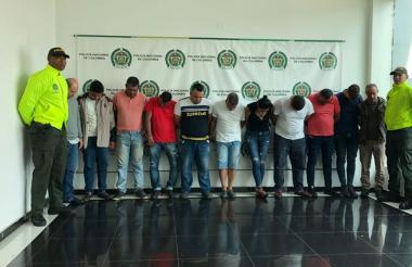 Los once presuntos miembros de la banda capturados.