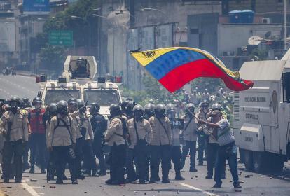 Aspectos de la manifestación de ayer en Caracas.