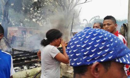 Una víctima se lamenta momentos después del incendio