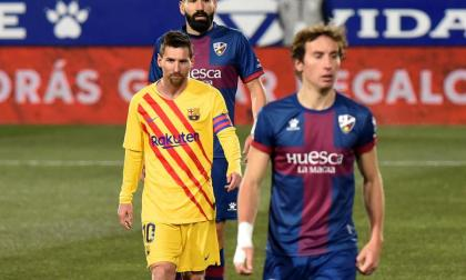 El Barça, con Messi, reacciona en Huesca