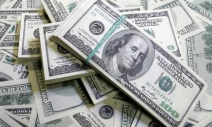 Dólar cae frente al peso tras posesión de Biden