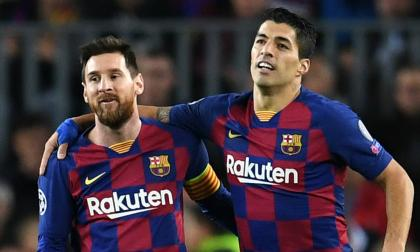 Lionel Messi en compañía de Luis Suárez.