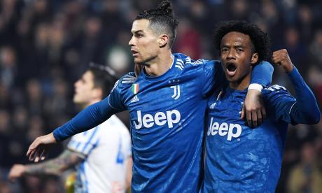 Cristiano celebrando su gol con Cuadrado.