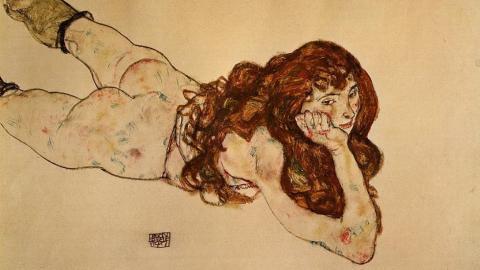 ‹Mujer desnuda yaciendo sobre su estómago› (1917).