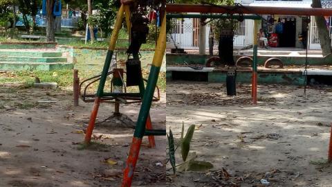 El parque solo cuenta con un par de columpios y una rueda rueda abandonados.