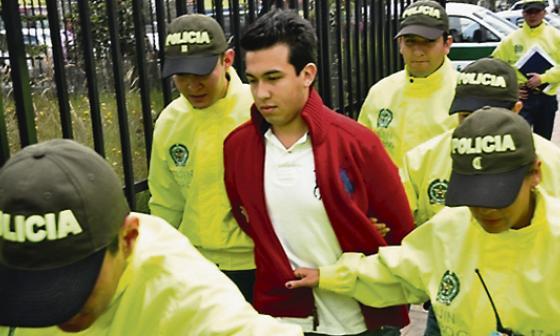 Carlos Cárdenas cuando fue retenido por la Policía.