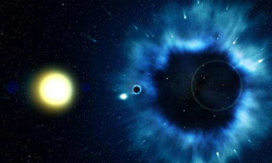 Un agujero negro es un objeto tan denso que su gravedad impide escapar incluso a la luz y en sus cercanías desvía la trayectoria de los haces luminosos.