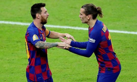 Griezmann junto a Messi en un partido del FC Barcelona.