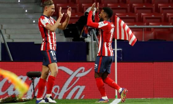 Lemar y Llorente le dan el liderato al Atlético
