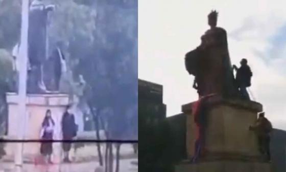 Indígenas Misak intentan derribar estatuas de Colón y Reina Isabel en Bogotá