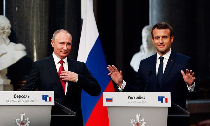 Macron dice ante Putin que responderá al uso de armas químicas en Siria