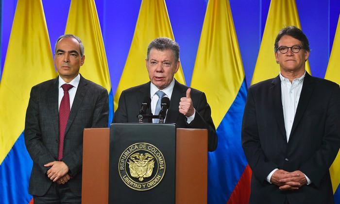 El ministro del Interior, Guillermo Rivera: el presidente Juan Manuel Santos y el jefe del Equipo de Gobierno con el Eln.