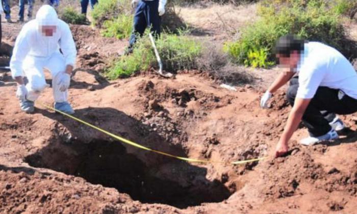 Autoridades descubren 12 cadáveres en fosa clandestina cavada en una casa