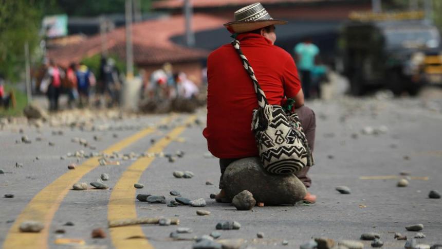 Recuperación económica podría frenarse por la pandemia y bloqueos, según OCDE