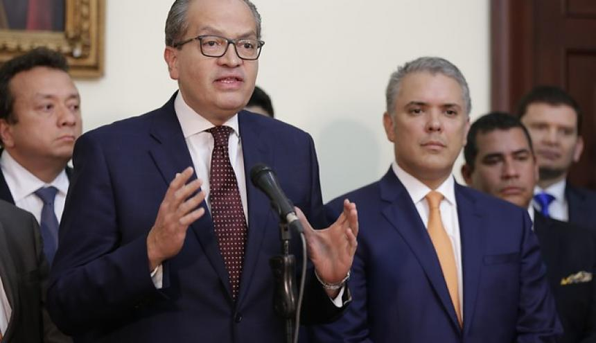 Procurador Carrillo (izq.) junto al presidente Duque.